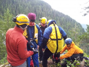 SAR members and subjects suiting up for Long Line (HETS) extraction