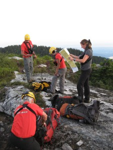 SAR team planning search after being dropped off.