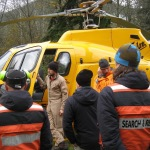Talong Helicopters pilot Jarret Lunn briefs the new spotters